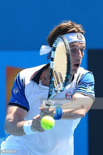 Daniel GimenoTraver of Spain plays a backhand in his first round match against Milos Raonic of Canada during day two of the 2014 Australian Open at...