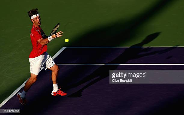 Daniel GimenoTraver of Spain plays a forehand against Tomas Berdych of Czech Republic during their second round match at the Sony Open at Crandon...