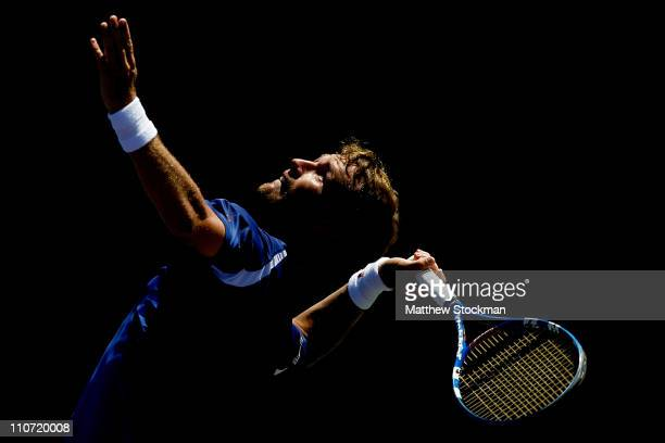 Daniel GimenoTraver of Spain serves against Julien Benneteau of France during the Sony Ericsson Open at Crandon Park Tennis Center on March 23 2011...