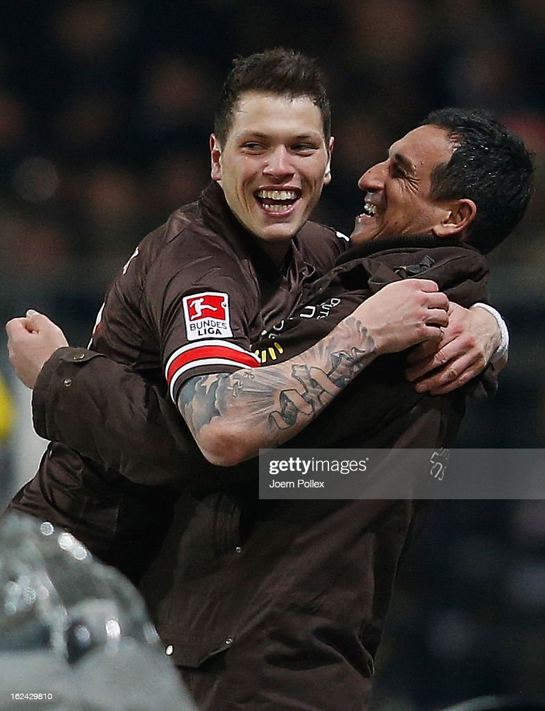 Daniel Ginczek of St. Pauli celebrates with his sporting director Rachid Azzouzi after scoring his team's second goal during the Second Bundesliga match between 1. FC St. Pauli and FSV Frankfurt 1899 at Millerntor Stadium on February 22, 2013 in Hamburg, Germany.