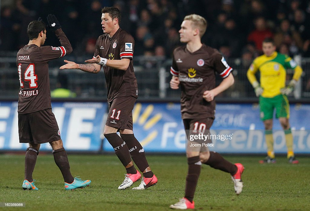 Daniel Ginczek (2nd L) of St. Pauli celebrates with his team mates after scoring his team's third goal during the Second Bundesliga match between 1. FC St. Pauli and FSV Frankfurt 1899 at Millerntor Stadium on February 22, 2013 in Hamburg, Germany.