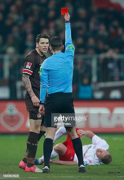 Daniel Ginczek of St Pauli gets the red card from referee Marcel Unger during the Second Bundesliga match between FC St Pauli and SSV Jahn Regensburg...