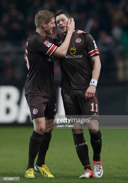 Daniel Ginczek of St. Pauli is congratulated by team-mate Florian Kringe after scoring their team's second goal during the Second Bundesliga match...