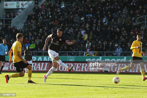 Daniel Ginczek of St. Pauli scores his team's third goal during the Second Bundesliga match between FC St. Pauli and Dynamo Dresden at the Millerntor...