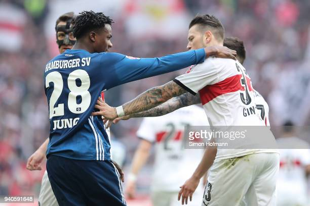 Daniel Ginczek of Stuttgart and Gideon Jung of Hamburg during an argument after Ginczek scored a goal to make it 11 during the Bundesliga match...