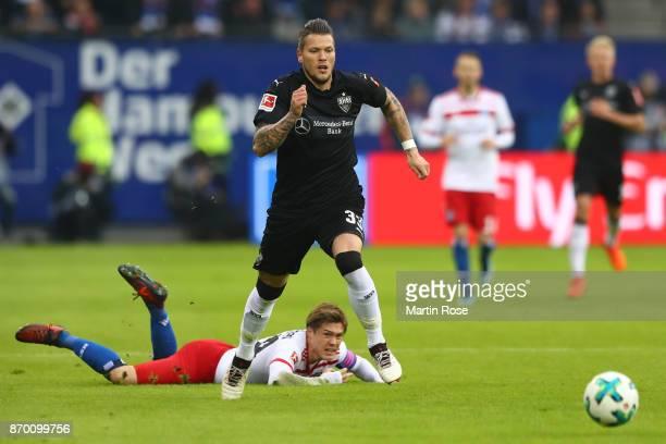 Daniel Ginczek of Stuttgart and Gotoku Sakaiof Hamburg fight for the ball during the Bundesliga match between Hamburger SV and VfB Stuttgart at...