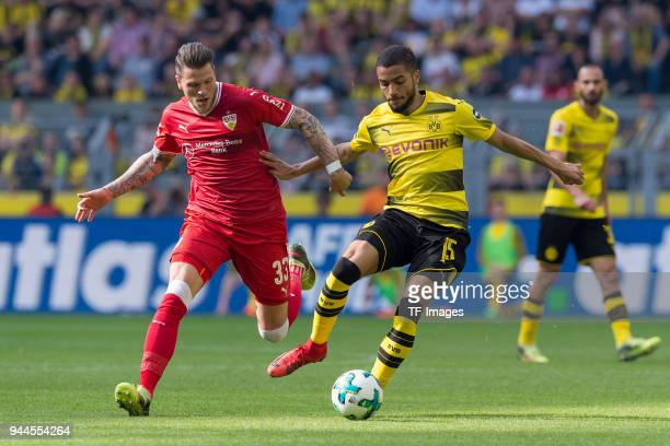 Daniel Ginczek of Stuttgart and Jeremy Toljan of Dortmund battle for the ball during the Bundesliga match between Borussia Dortmund and VfB Stuttgart...