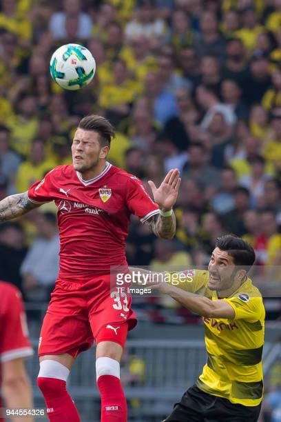 Daniel Ginczek of Stuttgart and Nuri Sahin of Dortmund battle for the ball during the Bundesliga match between Borussia Dortmund and VfB Stuttgart at...