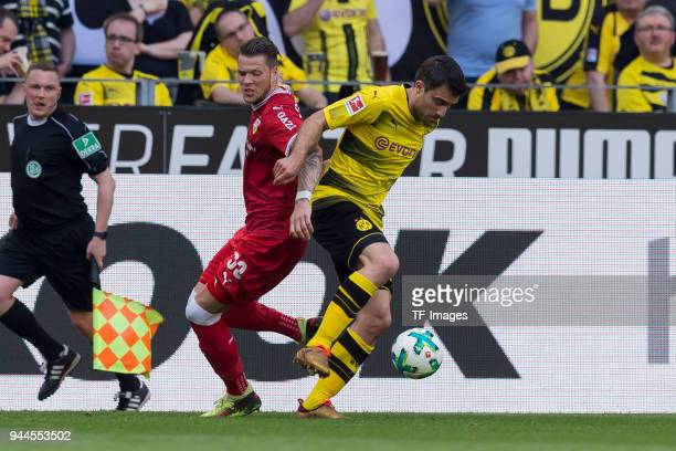 Daniel Ginczek of Stuttgart and Sokratis of Dortmund battle for the ball during the Bundesliga match between Borussia Dortmund and VfB Stuttgart at...