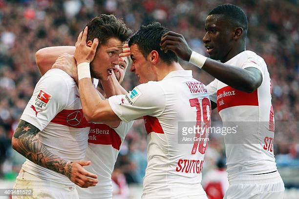 Daniel Ginczek of Stuttgart celebrates his team's second goal with team mates Alexandru Maxim Filip Kostic and Antonio Ruediger during the Bundesliga...