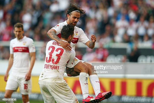 Daniel Ginczek of Stuttgart celebrates his team's second goal with team mate Martin Harnik during the Bundesliga match between VfB Stuttgart and SV...