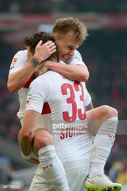 Daniel Ginczek of Stuttgart celebrates scoring the 2nd team goal with his team mate Alexandru Maxim during the Bundesliga match between VfB Stuttgart...