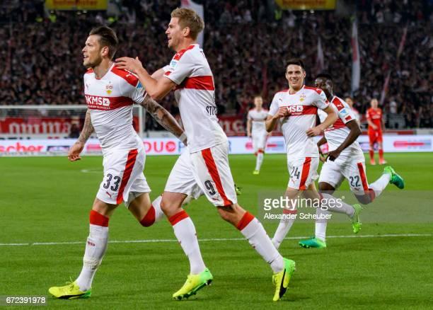 Daniel Ginczek of Stuttgart celebrates the third goal for his team with Simon Terodde of Stuttgart during the Second Bundesliga match between VfB...