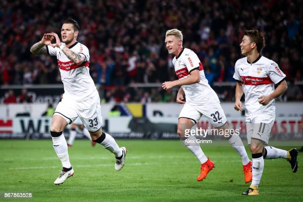 Daniel Ginczek of Stuttgart celebrates with Andreas Beck and Takuma Asano after scoring his team's first goal to make it 10 during the Bundesliga...