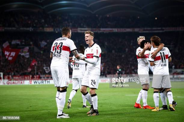 Daniel Ginczek of Stuttgart celebrates with Dzenis Burnic and his teammates after scoring his team's first goal to make it 10 during the Bundesliga...