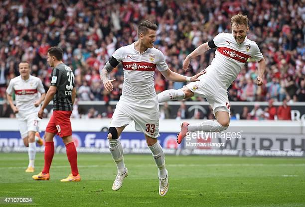 Daniel Ginczek of Stuttgart celebrates with his teammate Alexandru Maxim of Stuttgart after scoring his team's first goal during the Bundesliga match...