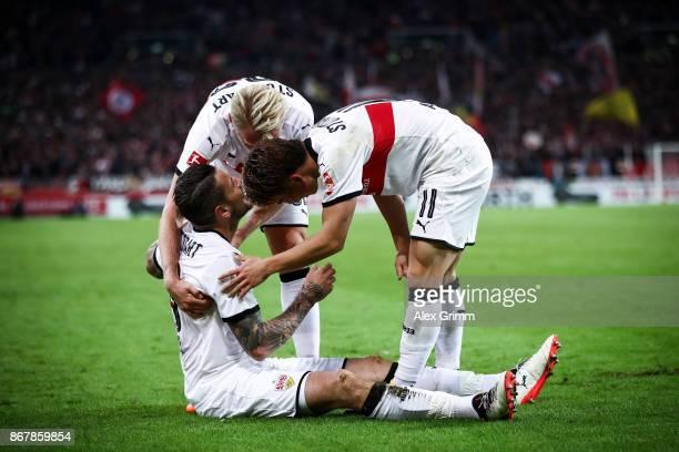 Daniel Ginczek of Stuttgart celebrates with his teammates after scoring his team's first goal to make it 10 during the Bundesliga match between VfB...