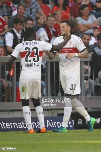 Daniel Ginczek of Stuttgart celebrates with Orel Mangala of Stuttgart after he scored a goal to make it 14 during the Bundesliga match between FC...
