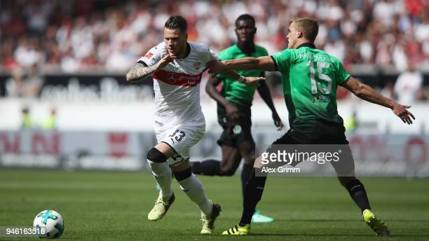 Daniel Ginczek of Stuttgart eludes Timo Huebers of Hannover during the Bundesliga match between VfB Stuttgart and Hannover 96 at MercedesBenz Arena...
