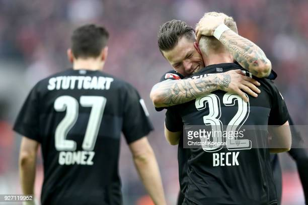 Daniel Ginczek of Stuttgart embraces Andreas Beck of Stuttgart who scored the third goal during the Bundesliga match between 1 FC Koeln and VfB...
