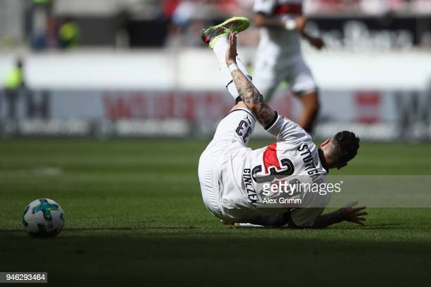 Daniel Ginczek of Stuttgart falls during the Bundesliga match between VfB Stuttgart and Hannover 96 at MercedesBenz Arena on April 14 2018 in...