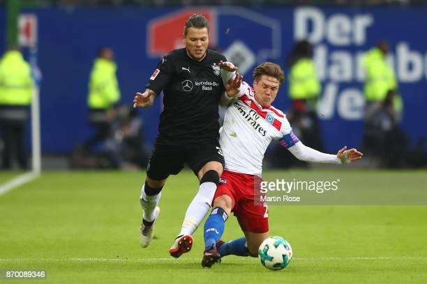 Daniel Ginczek of Stuttgart fights for the ball with Gotoku Sakaiof Hamburg during the Bundesliga match between Hamburger SV and VfB Stuttgart at...