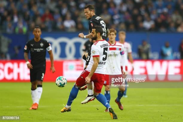Daniel Ginczek of Stuttgart fights for the ball with Mergim Mavraj of Hamburg during the Bundesliga match between Hamburger SV and VfB Stuttgart at...