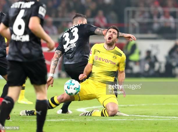 Daniel Ginczek of Stuttgart fouls Sokratis Papastathopoulos of Dortmund during the Bundesliga match between VfB Stuttgart and Borussia Dortmund at...