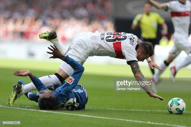 Daniel Ginczek of Stuttgart is being fouled by Gideon Jung of Hamburg during the Bundesliga match between VfB Stuttgart and Hamburger SV at...