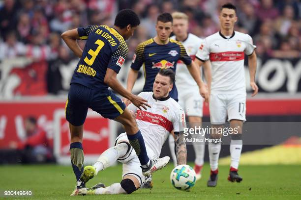 Daniel Ginczek of Stuttgart is challenged by Bernardo of Leipzig during the Bundesliga match between VfB Stuttgart and RB Leipzig at MercedesBenz...