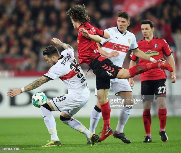 Daniel Ginczek of Stuttgart is challenged by Caglar Souyuencue of Freiburg during the Bundesliga match between SportClub Freiburg and VfB Stuttgart...