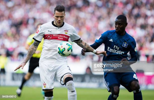 Daniel Ginczek of Stuttgart is challenged by Stephan Ambrosius of Hamburg during the Bundesliga match between VfB Stuttgart and Hamburger SV at...