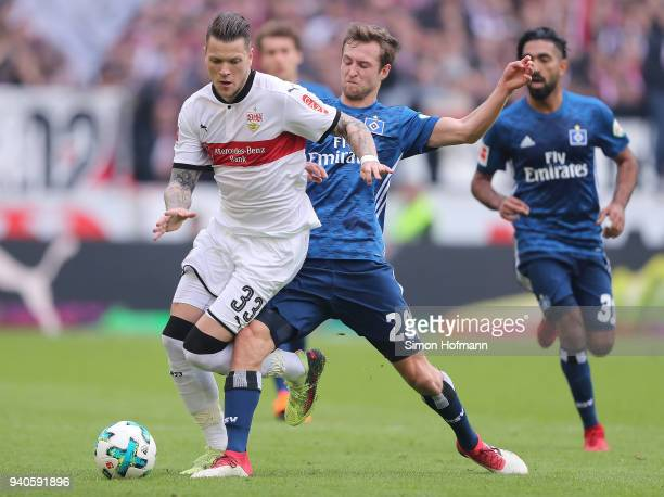 Daniel Ginczek of Stuttgart is chased by Matti Ville Steinmann of Hamburg during the Bundesliga match between VfB Stuttgart and Hamburger SV at...
