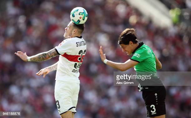 Daniel Ginczek of Stuttgart jumps for a header with Miiko Albornoz of Hannover during the Bundesliga match between VfB Stuttgart and Hannover 96 at...