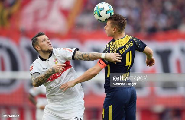 Daniel Ginczek of Stuttgart jumps for a header with Willi Orban of Leipzig during the Bundesliga match between VfB Stuttgart and RB Leipzig at...