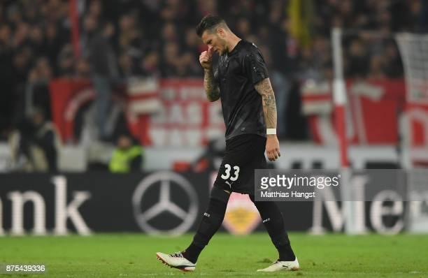 Daniel Ginczek of Stuttgart leaves injured the pitch during the Bundesliga match between VfB Stuttgart and Borussia Dortmund at MercedesBenz Arena on...