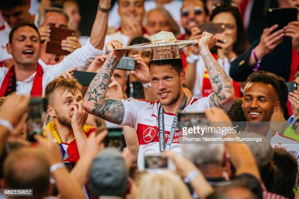 Daniel Ginczek of Stuttgart lifts the Meisterschale as players and staffs celebrate the Second Bundesliga champions after the Second Bundesliga match...