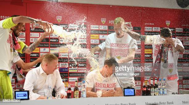 Daniel Ginczek of Stuttgart poors beer over his head coach Hannes Wolf during a press conference after winning the 2 Second Bundesliga Championship...