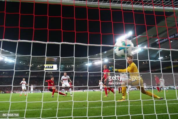 Daniel Ginczek of Stuttgart scores his team's first goal against Alexander Schwolow goalkeeper of Freiburg to make it 10 during the Bundesliga match...