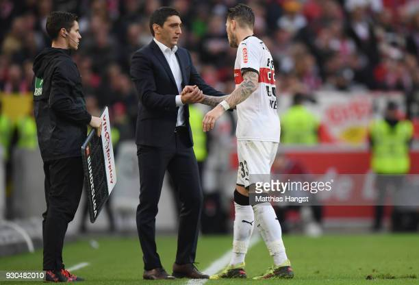 Daniel Ginczek of Stuttgart shakes hands with head coach Tayfun Korkut during the Bundesliga match between VfB Stuttgart and RB Leipzig at...
