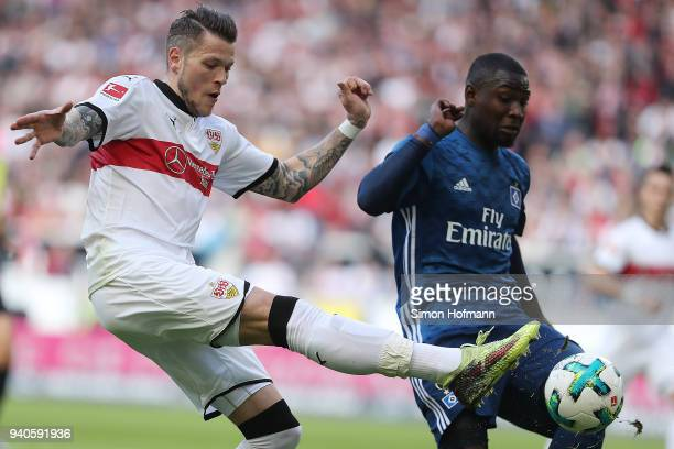 Daniel Ginczek of Stuttgart tries to shoot past Stephan Ambrosius of Hamburg during the Bundesliga match between VfB Stuttgart and Hamburger SV at...