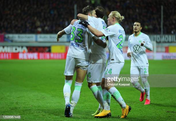 Daniel Ginczek of VfL Wolfsburg celebrates with his teammates after scoring his sides second goal during the Bundesliga match between SC Paderborn 07...