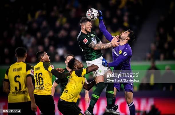 Daniel Ginczek of Wolfsburg and Roman Buerki of Dortmund challenges for the ball during the Bundesliga match between VfL Wolfsburg and Borussia...