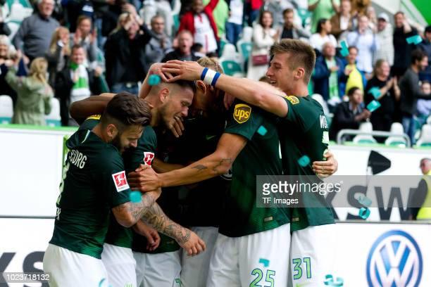 Daniel Ginczek of Wolfsburg celebrates after scoring his team`s second goal during the Bundesliga match between VfL Wolfsburg and FC Schalke 04 at...