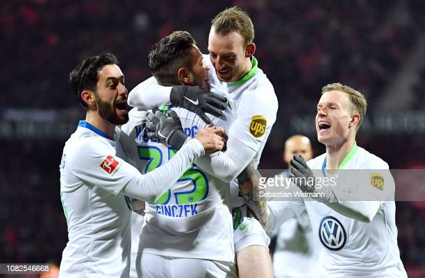 Daniel Ginczek of Wolfsburg celebrates his team's first goal with team mates during the Bundesliga match between 1 FC Nuernberg and VfL Wolfsburg at...
