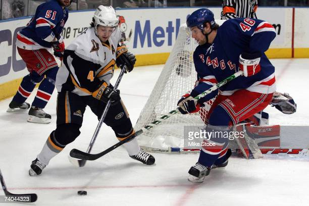 Daniel Girardi of the New York Rangers defends against Daniel Briere of the Buffalo Sabres during Game Four of the 2007 Eastern Conference Semifinals...