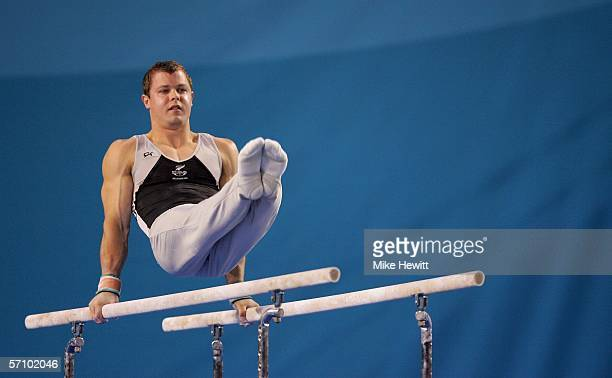 Daniel Good of New Zealand competes on the parallel bars during the Men's Team competition in the artistic gymnastics at the Rod Laver Arena during...