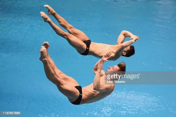 Daniel Goodfellow and Jack Laugher of Great Britain compete during the Men's 3m Synchro Springboard Final on day one of the FINA Diving World Cup...