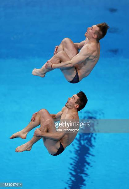 Daniel Goodfellow and Jack Laugher of Team Great Britain compete during the Men's Synchronised 3m Springboard final on day five of the Tokyo 2020...