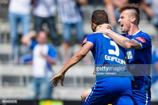 Daniel Gordon of Karlsruhe celebrates his team's second goal with team mate Marvin Pourie during the 3 Liga match between VfR Aalen and Karlsruher SC...